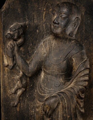 View 4. Thumbnail of Lot 51. A rare limestone carving of a Buddhist acolyte, possibly Jianglong Luohan Northern Song dynasty, 10th-11th century   北宋十至十一世紀 石灰石浮雕或為降龍羅漢像.