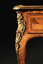 A LOUIS XV GILT-BRONZE MOUNTED TULIPWOOD AND AMARANTH BUREAU PLAT BY LÉONARD BOUDIN | BUREAU PLAT EN PLACAGE DE BOIS DE ROSE ET D'AMARANTE À MONTURE DE BRONZE REDORÉ D'ÉPOQUE LOUIS XV, PAR LÉONARD BOUDIN