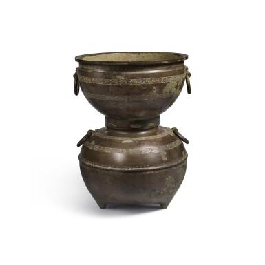 View 1. Thumbnail of Lot 20. An archaic bronze ritual food steamer (Yan), Eastern Zhou dynasty, early Warring States period   東周 戰國初 青銅交龍紋鋪首耳甗.