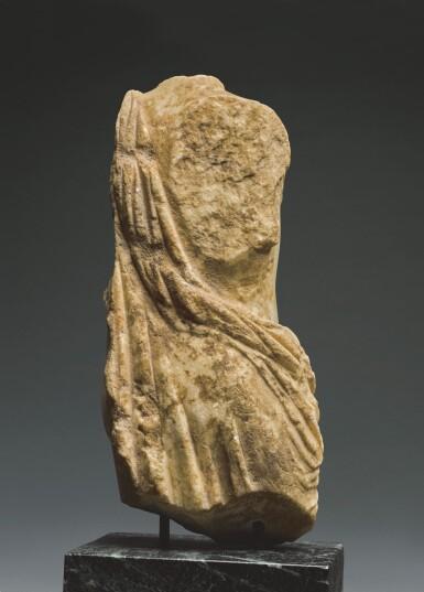 View 2. Thumbnail of Lot 36. A ROMAN MARBLE TORSO OF DIONYSOS, CIRCA 2ND CENTURY A.D..