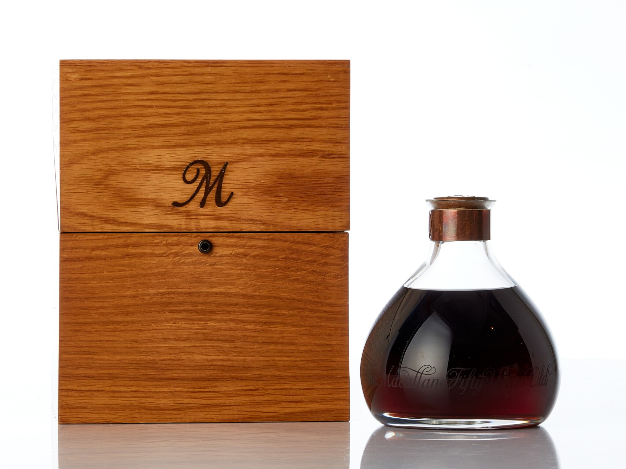 View full screen - View 1 of Lot 5505. The Macallan Millennium Decanter 50 Year Old 43.0 abv 1949 (1 BT75)     .
