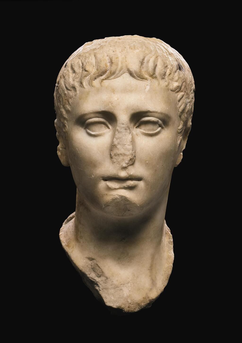A ROMAN MARBLE PORTRAIT HEAD OF A YOUTH, JULIO-CLAUDIAN, EARLY 1ST CENTURY A.D.
