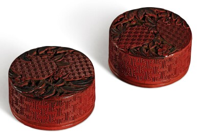 A PAIR OF CARVED POLYCHROME LACQUER BOXES AND COVERS QING DYNASTY, QIANLONG PERIOD | 清乾隆 剔彩瑞果紋圓蓋盒一對