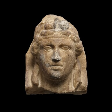 View 1. Thumbnail of Lot 64. A Roman Marble Herm Head of the Young Dionysos, circa 2nd Century A.D..