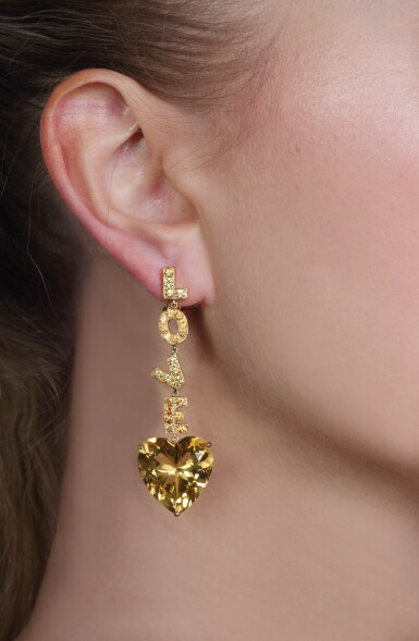 View 5. Thumbnail of Lot 50. Citrine and yellow sapphire pendent earrings, 'Love', Michele della Valle.