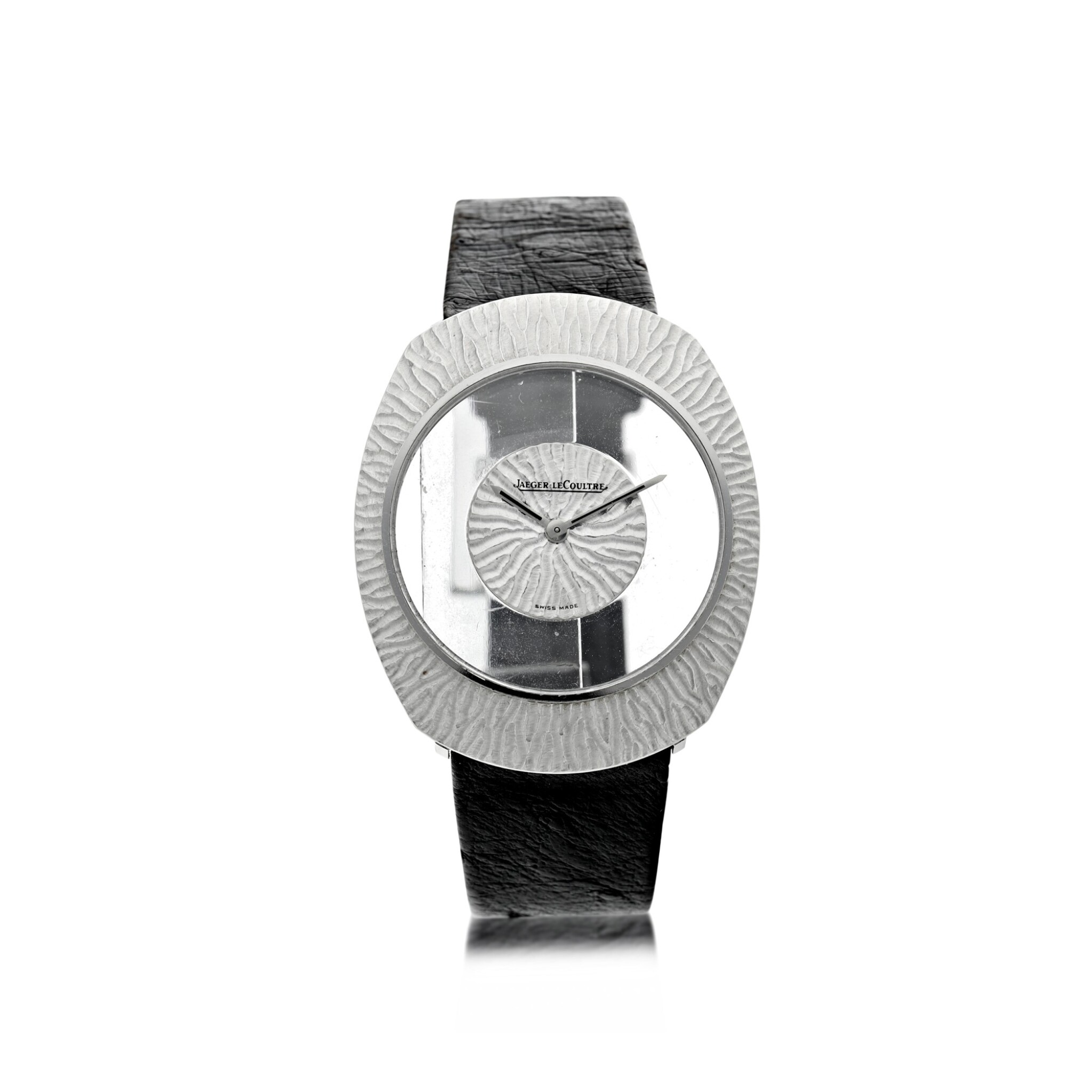 View full screen - View 1 of Lot 58. REFERENCE 17007 A WHITE GOLD OVAL MYSTERY WATCH, CIRCA 1965.