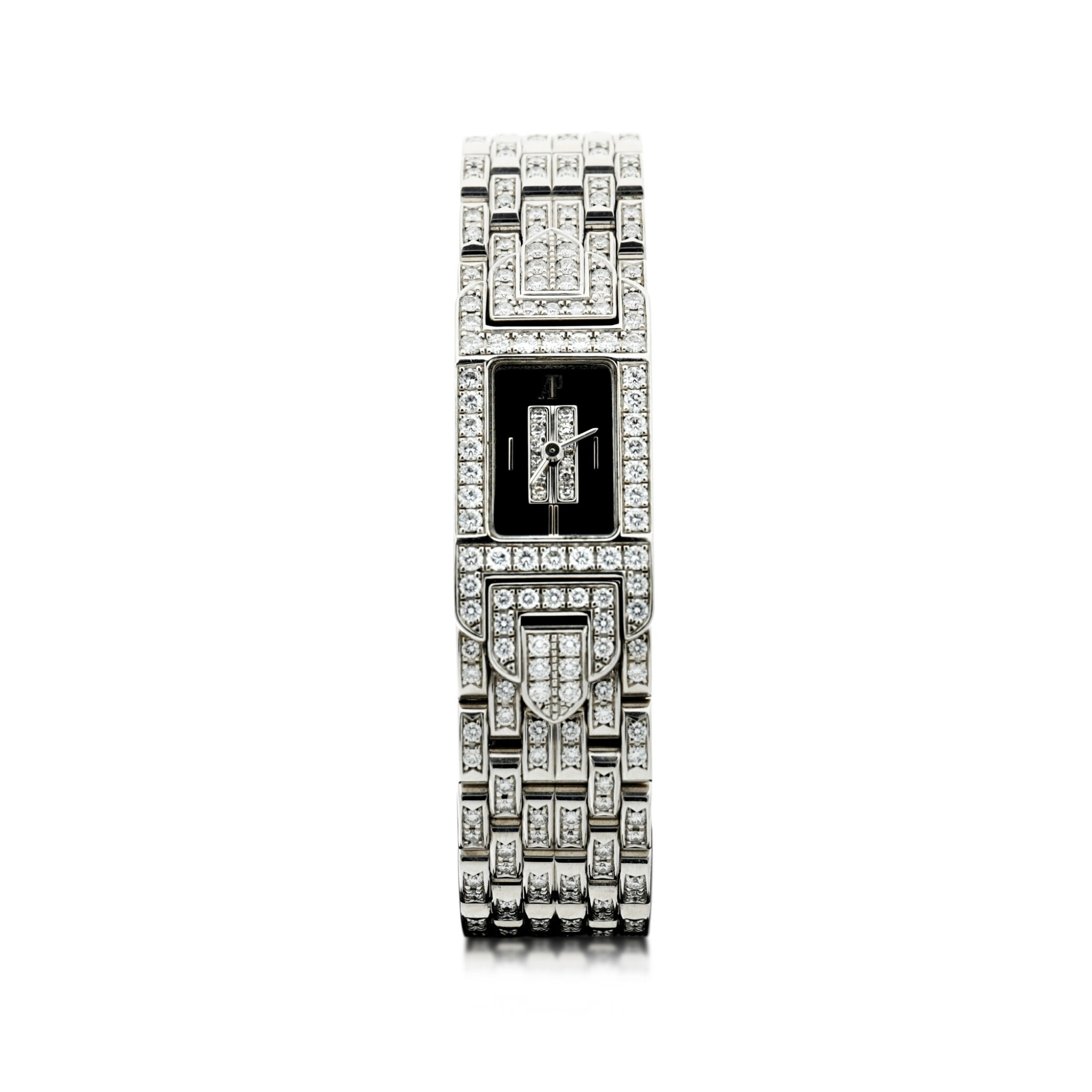 View full screen - View 1 of Lot 74. A LADY'S WHITE GOLD AND DIAMOND SET BRACELET WATCH WITH ONYX AND DIAMOND-SET DIAL, CIRCA 2005.