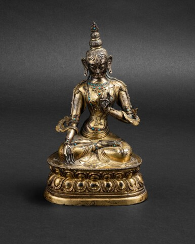 View 1. Thumbnail of Lot 48. Figure de Tara Blanche en cuivre doré repoussé Tibet, XVIIIE siècle | 西藏 十八世紀 鎏金銅白度母坐像 | A gilt-copper repoussé figure of the white Tara, Tibet 18th century.