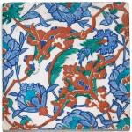 AN IZNIK POLYCHROME POTTERY TILE WITH INTERLACING SPLIT-PALMETTES AND LOTUS BLOSSOMS, TURKEY, CIRCA 1570