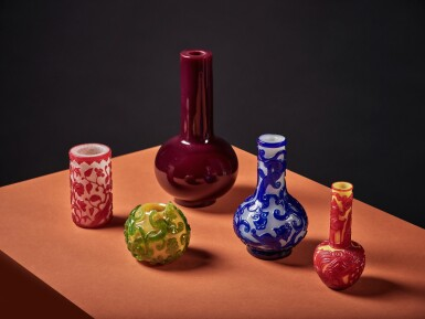 View 6. Thumbnail of Lot 60. A red overlay yellow glass 'landscape' bottle vase, Qing dynasty, 19th century.