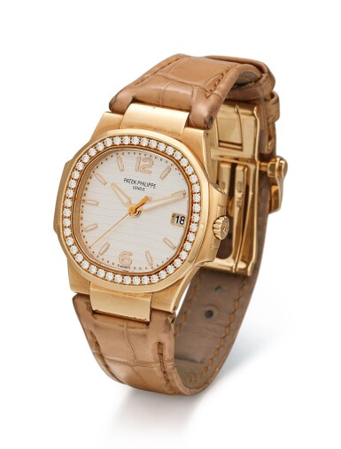 PATEK PHILIPPE | NAUTILUS, REFERENCE 7010 A PINK GOLD AND DIAMOND-SET WRISTWATCH WITH DATE, CIRCA 2010