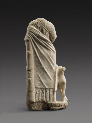 View 2. Thumbnail of Lot 23. A Greek Marble Figure of Aphrodite with Eros, late 4th Century B.C..