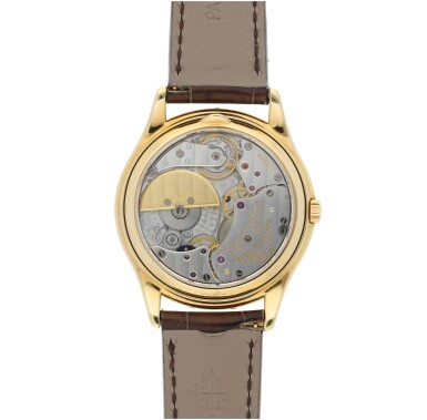 View 6. Thumbnail of Lot 52. PATEK PHILIPPE | REFERENCE 3941 A YELLOW GOLD AUTOMATIC PERPETUAL CALENDAR WRISTWATCH WITH MOON PHASES, CIRCA 1990.