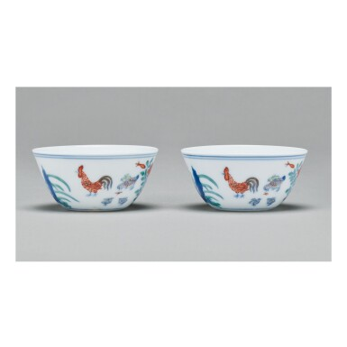 View 1. Thumbnail of Lot 112. A PAIR OF DOUCAI 'CHICKEN' CUPS,  QING DYNASTY, KANGXI PERIOD.