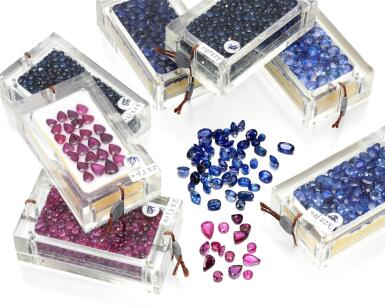 TWO CASES OF LOOSE SAPPHIRES AND ONE CASE OF LOOSE RUBIES