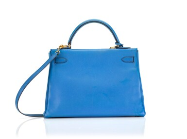 View 2. Thumbnail of Lot 16. KELLY 32 RETOURNE BLUE FRANCE COLOUR IN COURCHEVEL LEATHER WITH GOLD HARDWARE. HERMÈS, 1992 .
