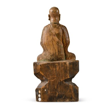 View 4. Thumbnail of Lot 108. A polychrome-painted wood figure of a luohan, Ming dynasty | 明 木雕加彩羅漢坐像.