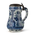 A DUTCH DELFT BLUE AND WHITE JUG, CIRCA 1720