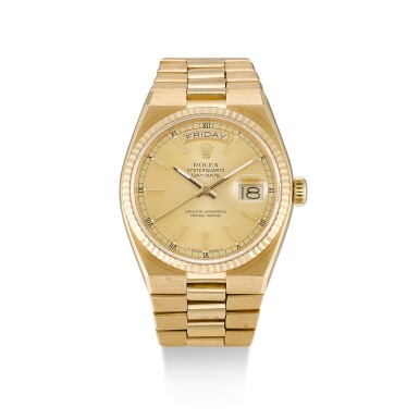 ROLEX  |  OYSTERQUARTZ DAY-DATE, REFERENCE 19018,  A YELLOW GOLD BRACELET WATCH WITH DAY AND DATE, CIRCA 1986