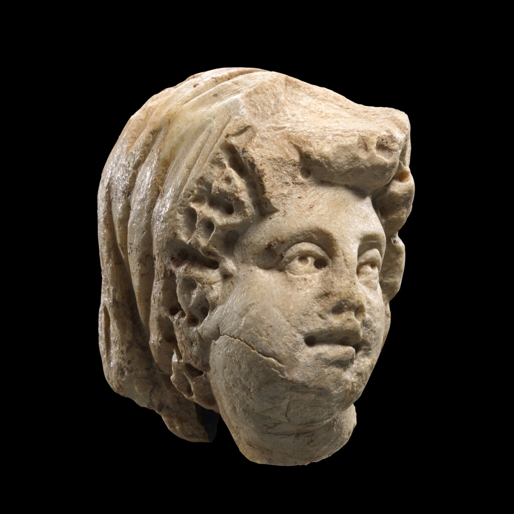 A ROMAN MARBLE RELIEF HEAD OF A WOMAN, 3RD CENTURY A.D.