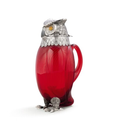 View 1. Thumbnail of Lot 53. A red glass owl decanter with silver head, neck, and feet, Cartier, Paris, 20th century.