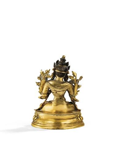 View 2. Thumbnail of Lot 22. STATUETTE DE TARA BLANCHE EN BRONZE DORÉ DYNASTIE QING, XVIIIE-XIXE SIÈCLE |  清十八至十九世紀 鎏金銅白度母坐像 | A gilt-bronze figure of White Tara, Qing Dynasty, 18th/19th century.