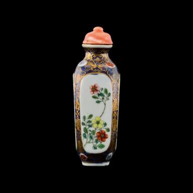 View 1. Thumbnail of Lot 1016. A famille-rose porcelain snuff bottle Seal mark and period of Qianlong   清乾隆 藍地描金開光粉彩庭園人物圖鼻煙壺 《乾隆年製》款.