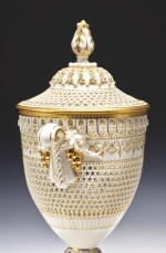 A ROYAL WORCESTER RETICULATED PORCELAIN VASE AND COVER BY GEORGE OWEN 1920