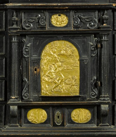 View 3. Thumbnail of Lot 86. A South German gilt-metal mounted, ebonised and carved table cabinet, possibly Augsburg, early 17th century.