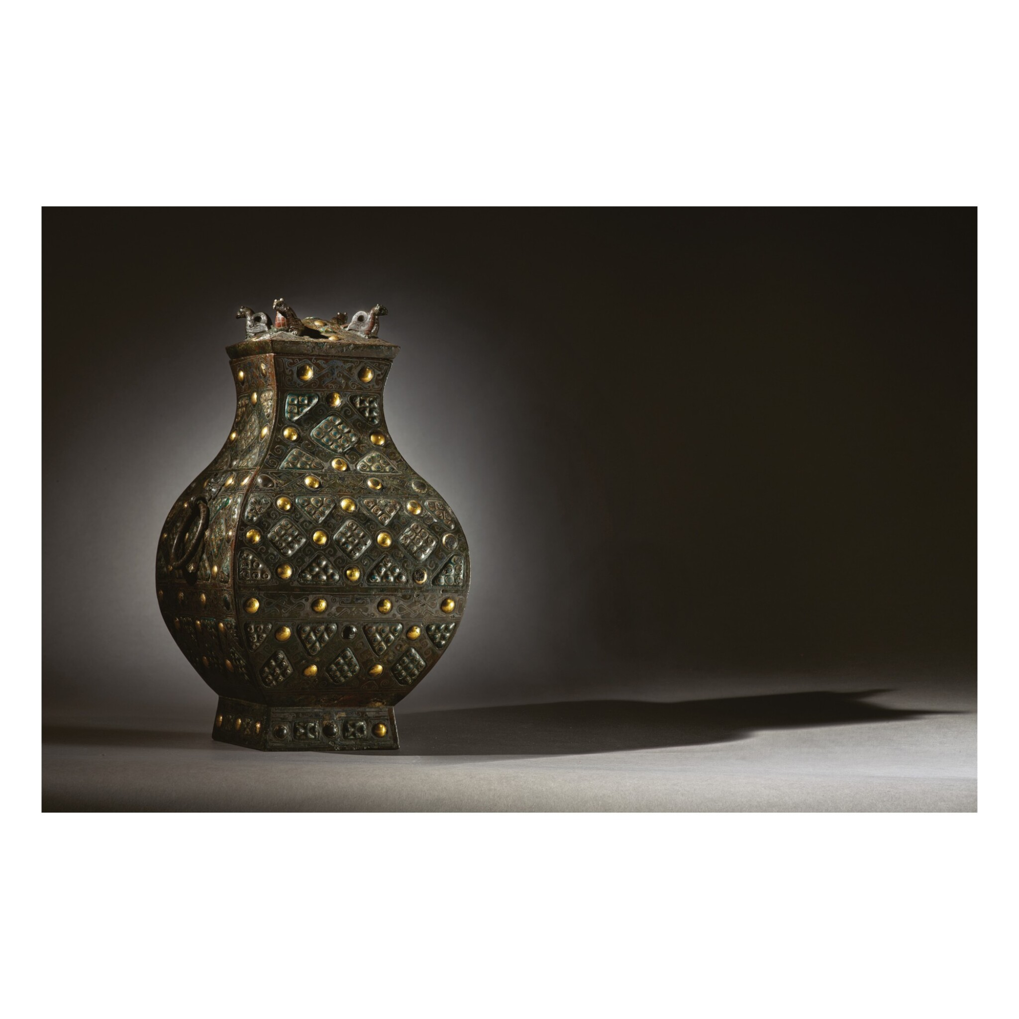 View 1 of Lot 578. AN EXCEPTIONALLY RARE AND IMPORTANT GOLD, SILVER AND GLASS-EMBELLISHED BRONZE VESSEL (FANG HU),  WARRING STATES PERIOD, 4TH / 3RD CENTURY BC.