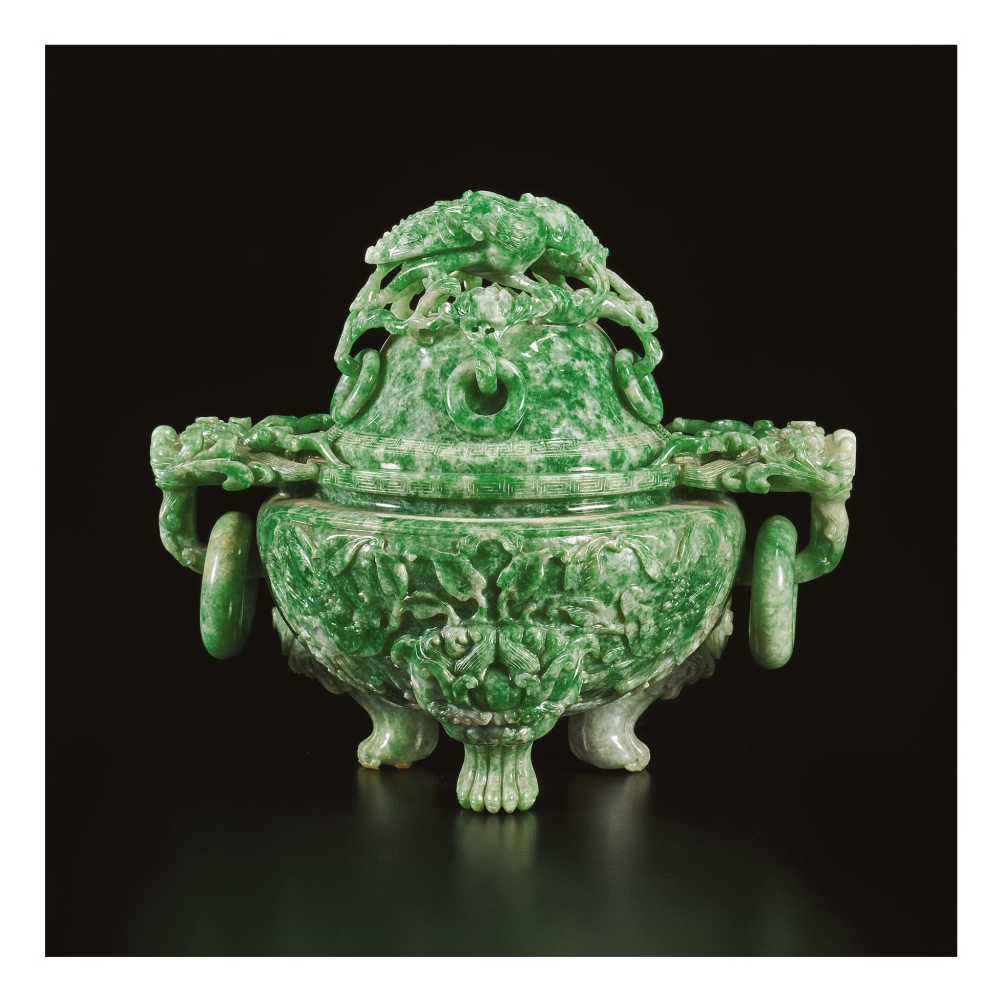 View 1 of Lot 668. AN APPLE-GREEN JADEITE TRIPOD CENSER AND COVER, QING DYNASTY, LATE 19TH / EARLY 20TH CENTURY.