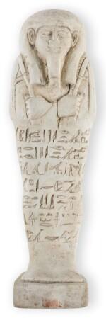AN EGYPTIAN FAIENCE USHABTI, 26TH DYNASTY, CIRCA 664-525 B.C.