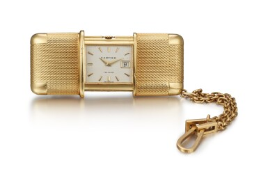 CARTIER   A YELLOW GOLD TRAVEL WATCH WITH DATE, CIRCA 1950