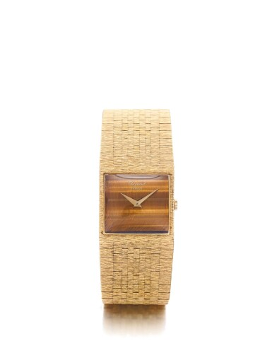 CHOPARD | A YELLOW GOLD BRACELET WATCH WITH TIGER'S EYE DIAL CIRCA 1980