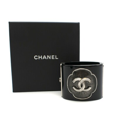 View 5. Thumbnail of Lot 174. CHANEL | BLACK PERSPEX CUFF WITH A RESIN FILLED CAMELIA STUDDED FLORAL OUTLINE AND ANTHRACITE TONE HARDWARE AND CC EMBELLISHMENT, 2015.