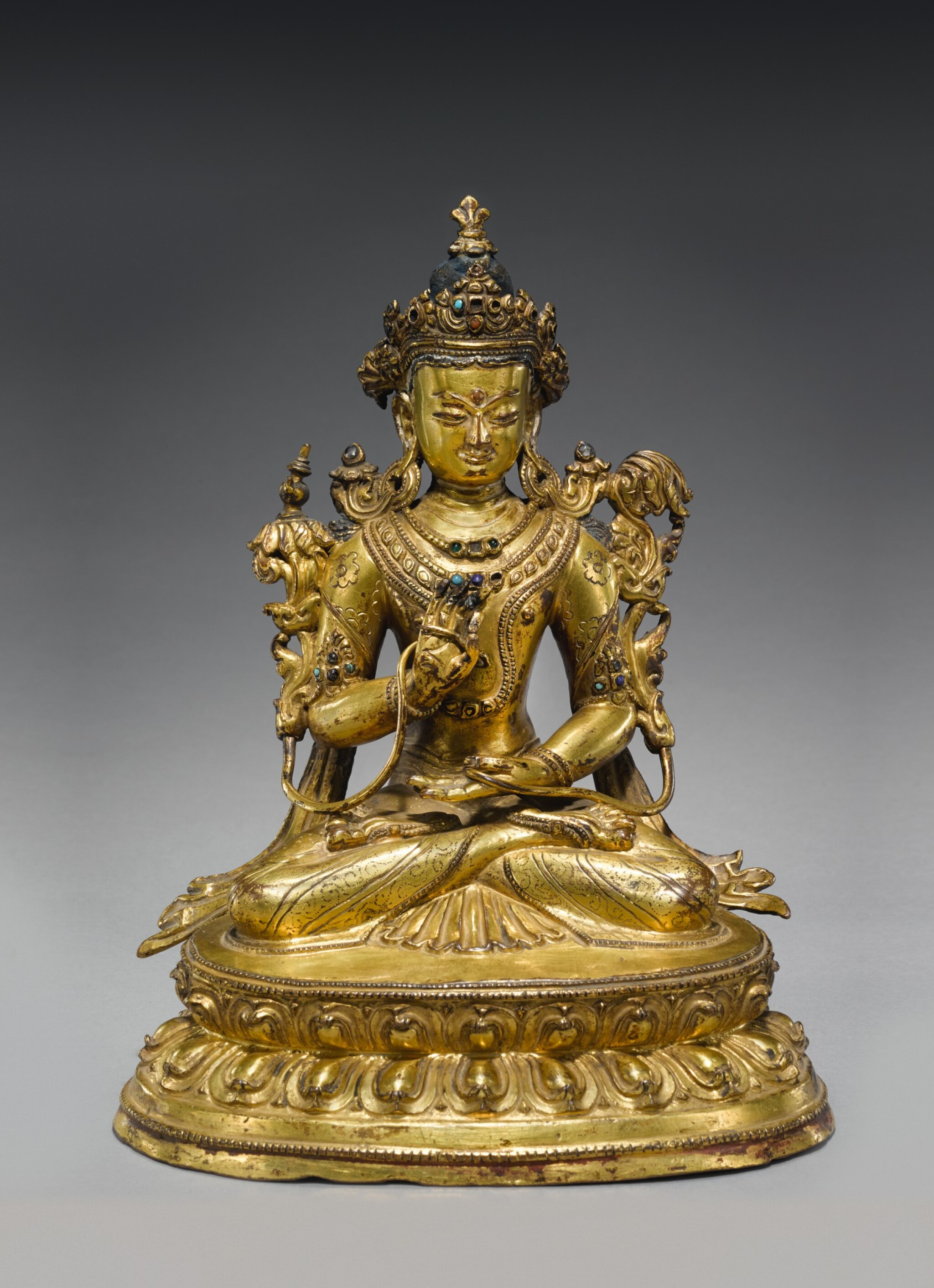 View full screen - View 1 of Lot 325. A GILT COPPER ALLOY FIGURE OF MAITREYA,  TIBET, 14TH/15TH CENTURY.
