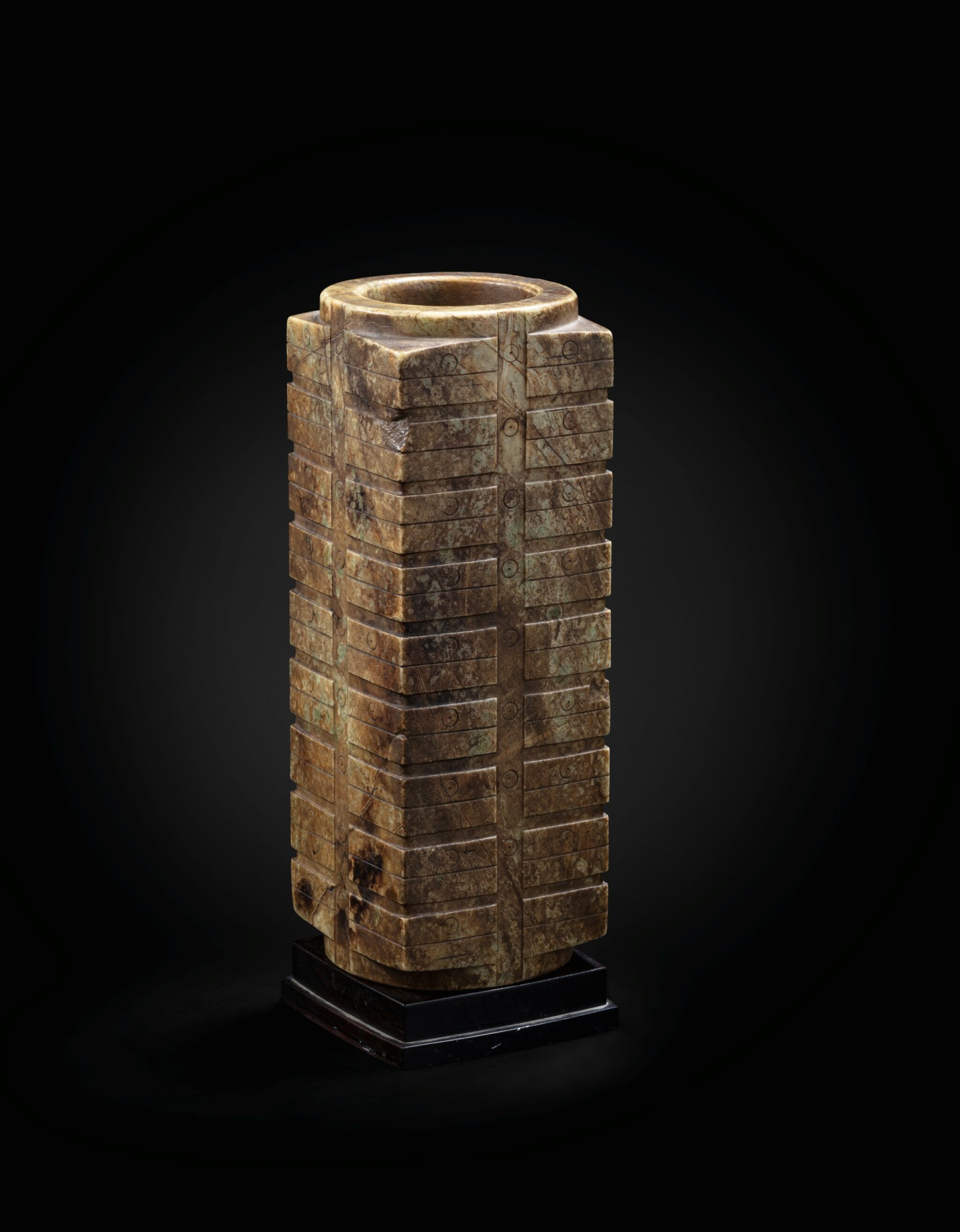 View full screen - View 1 of Lot 29. A large mottled brown jade nine-tier archaistic cong Ming dynasty or earlier   明或更早期 青玉琮.