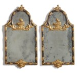 A PAIR OF ITALIAN EARLY ROCOCO STYLE SILVERED AND GILTWOOD MIRRORS