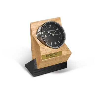 View 4. Thumbnail of Lot 724. STAINLESS STEEL DESK TIMEPIECE WITH ALARM AND WOODEN STAND CIRCA 2015.