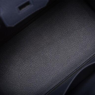 View 7. Thumbnail of Lot 4. Hermès Bleu Nuit Birkin 25cm of Togo Leather with Palladium Hardware.