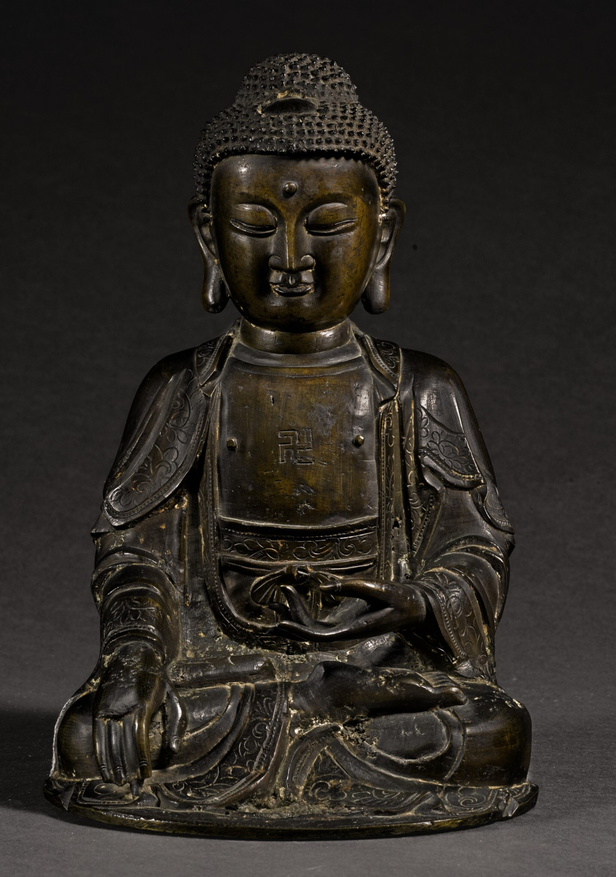 View full screen - View 1 of Lot 349. A BRONZE SEATED FIGURE OF SHAKYAMUNI MING DYNASTY, 16TH/17TH CENTURY | 明十六/十七世紀 銅釋迦穆尼坐像.