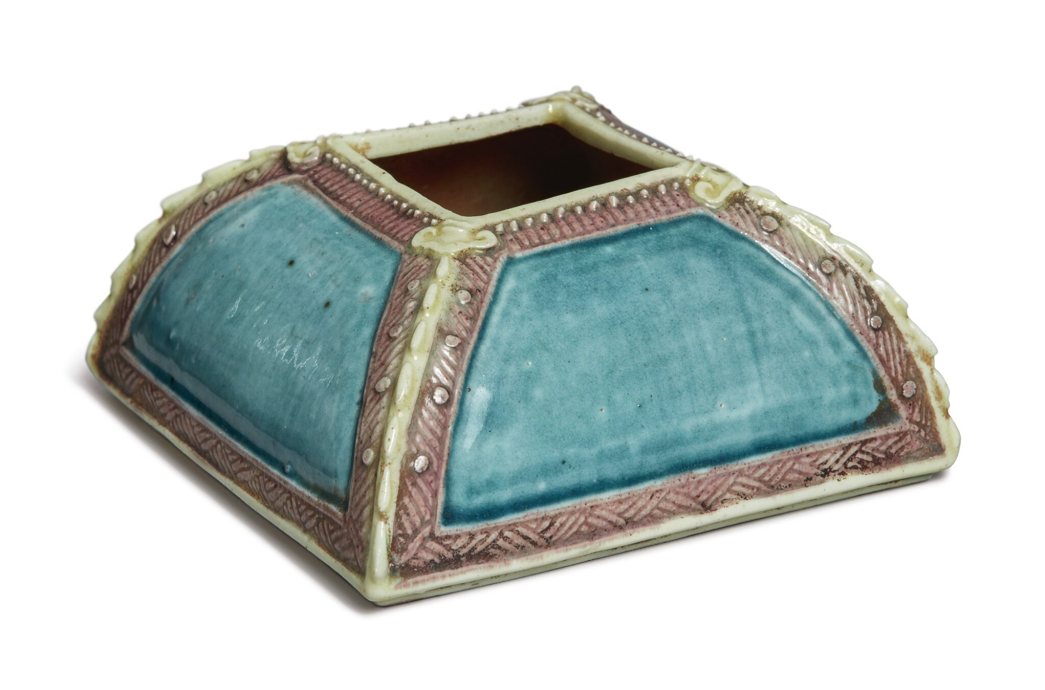 View 1 of Lot 1127. A SQUARE-SECTION TURQUOISE AND AUBERGINE-GLAZED WATERPOT, QING DYNASTY, 19TH CENTURY.