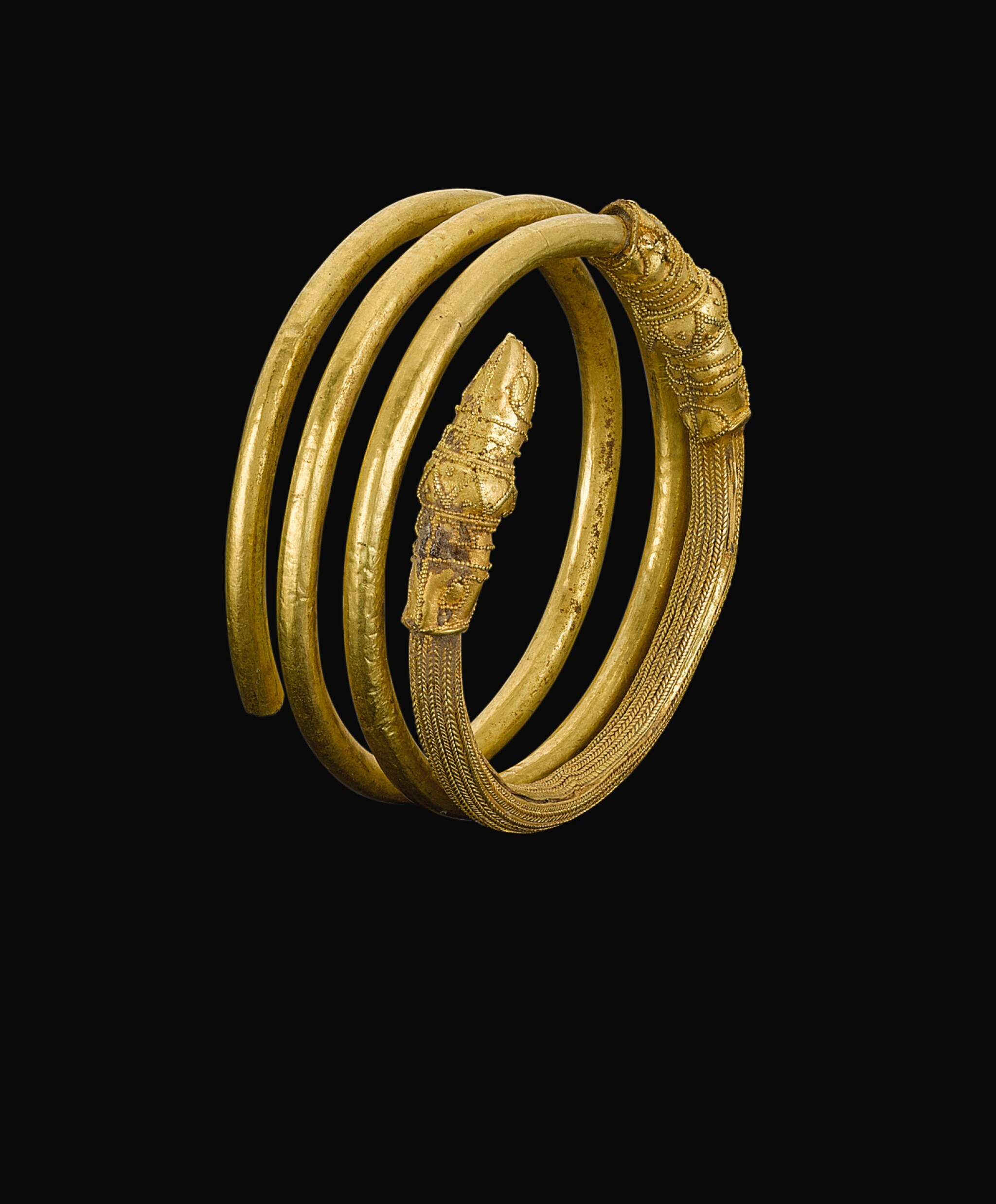 View full screen - View 1 of Lot 78. AN ETRUSCAN GOLD HAIR-RING, CIRCA 700-600 B.C..