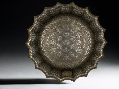 View 1. Thumbnail of Lot 74. A rare and important Khurasan silver-inlaid brass basin, probably Herat, circa 1200.
