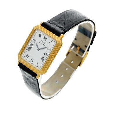 View 2. Thumbnail of Lot 138. Reference 7142 A yellow gold rectangular shaped wristwatch with ridged bezel, Circa 1975.