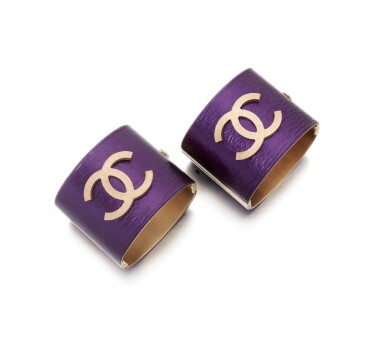 View 2. Thumbnail of Lot 83. Pair of purple leather wide cuffs.