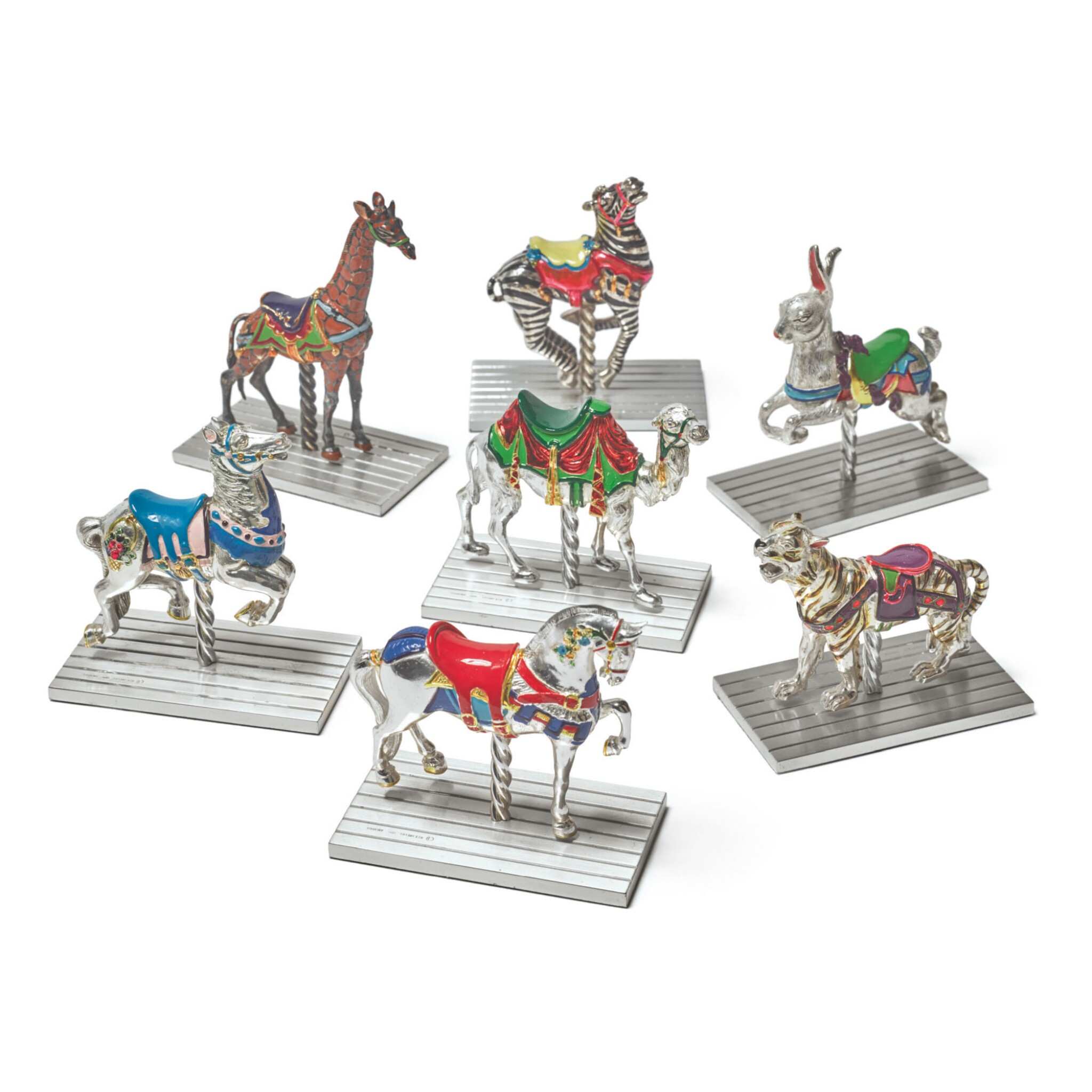 View full screen - View 1 of Lot 1851. A GROUP OF SEVEN SILVER AND ENAMEL CAROUSEL FIGURES, DESIGNED BY GENE MOORE FOR TIFFANY & CO., NEW YORK, CIRCA 1990.