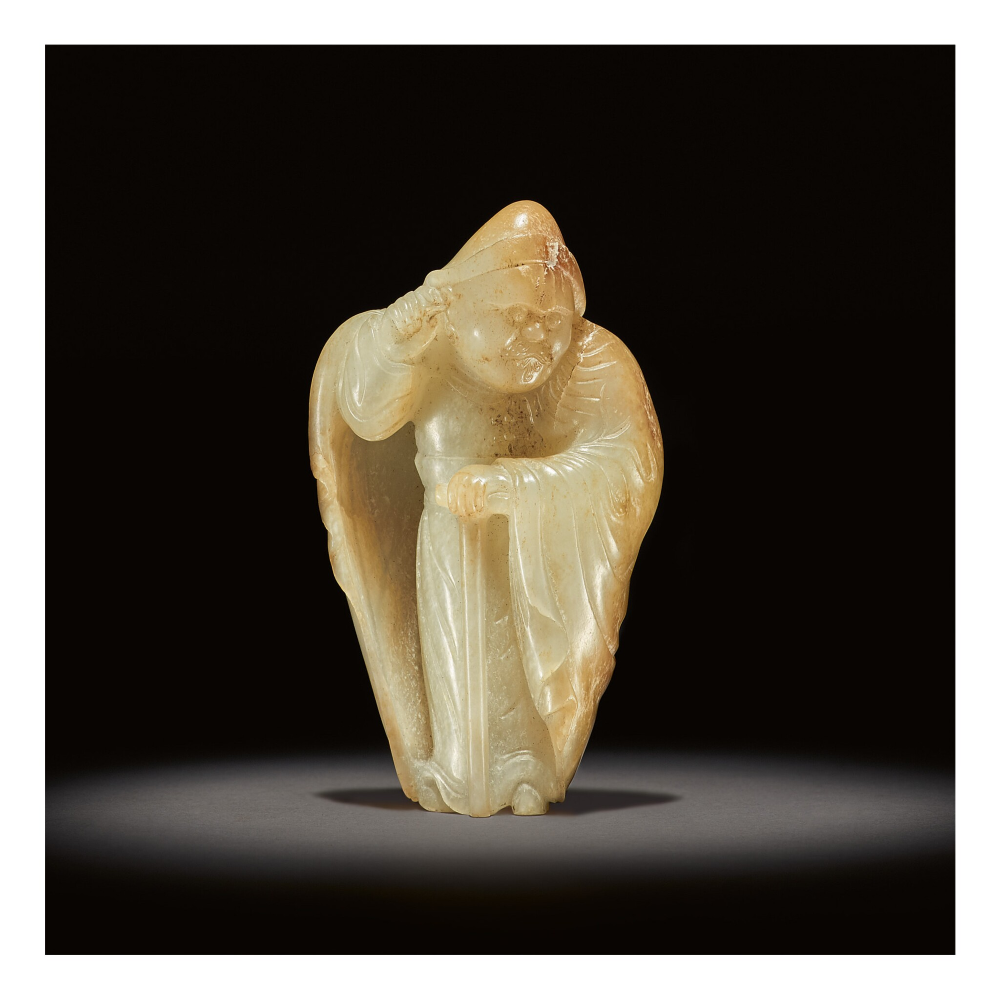 View full screen - View 1 of Lot 207. AN EXCEEDINGLY RARE WHITE AND RUSSET JADE CARVING OF A FOREIGNER,  TANG DYNASTY.