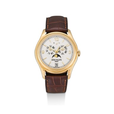 PATEK PHILIPPE | REFERENCE 5146   A YELLOW GOLD ANNUAL CALENDAR WRISTWATCH WITH MOON PHASES AND POWER RESERVE INDICATION, CIRCA 2008