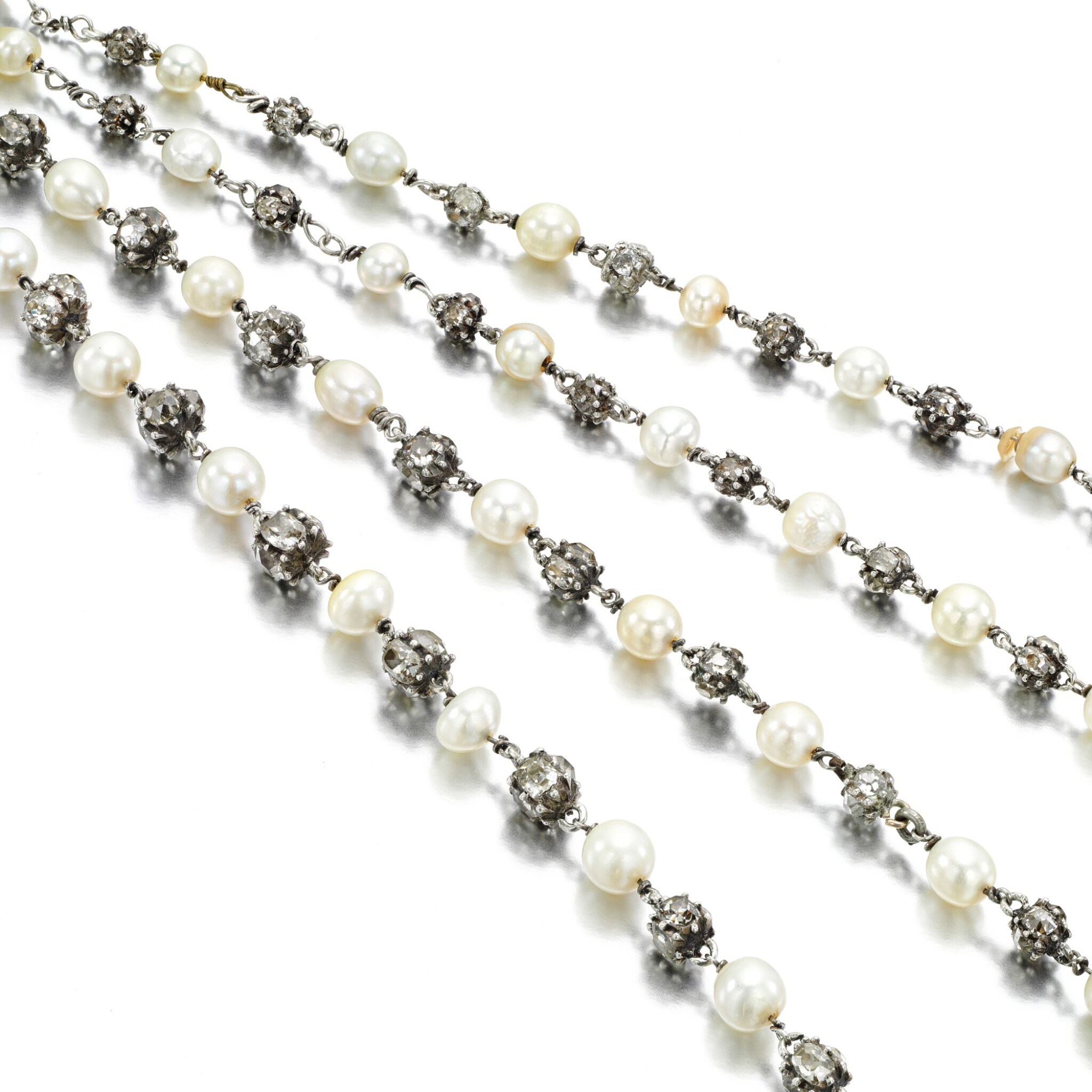 View full screen - View 1 of Lot 32. Natural pearl and diamond long chain, circa 1900.